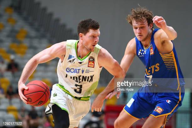 Cameron Gliddon of the Phoenix drives to the basket during the NBL Pre-Season match between the Brisbane Bullets and the South East Melbourne Phoenix...