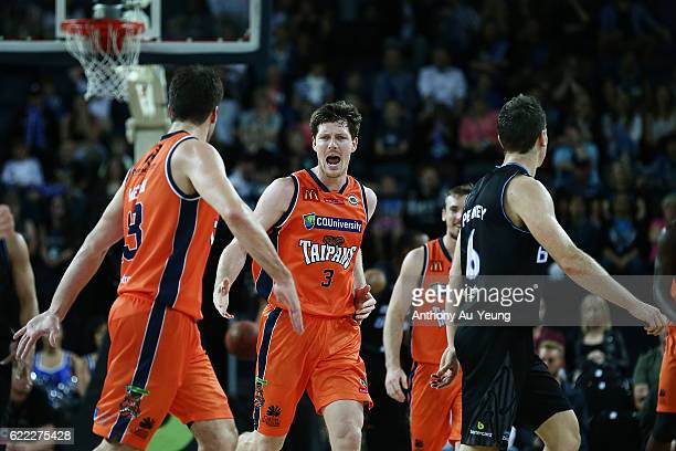 Cameron Gliddon of the Taipans celebrates with his team during the round six NBL match between the New Zealand Breakers and the Cairns Taipans at...