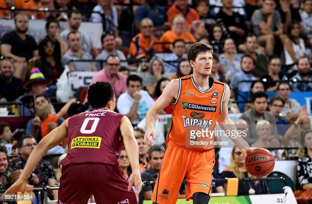 Cameron Gliddon of the Taipans looks to pass during the round 10 NBL match between the Cairns Taipans and the Brisbane Bullets at Cairns Convention...