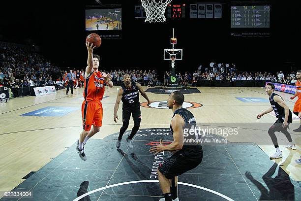 Cameron Gliddon of the Taipans scores a layup in the final minutes of the game during the round six NBL match between the New Zealand Breakers and...