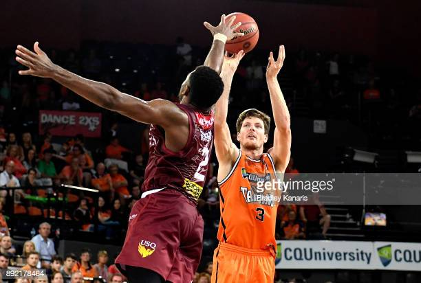Cameron Gliddon of the Taipans shoots during the round 10 NBL match between the Cairns Taipans and the Brisbane Bullets at Cairns Convention Centre...