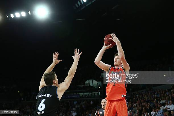 Cameron Gliddon of the Taipans shoots over Kirk Penney of the Breakers during the round six NBL match between the New Zealand Breakers and the Cairns...