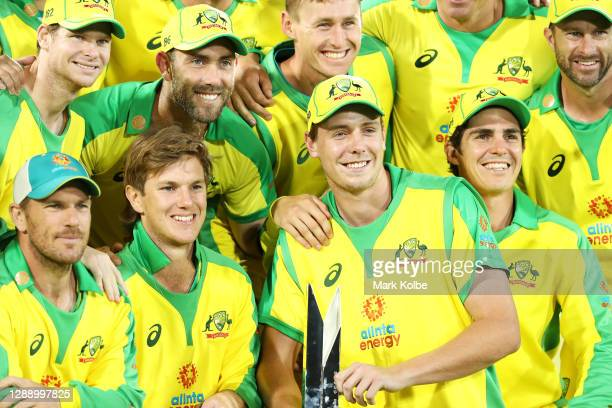Cameron Green holds the trophy as the Australian team pose after their series win 2-1 after game three of the One Day International series between...