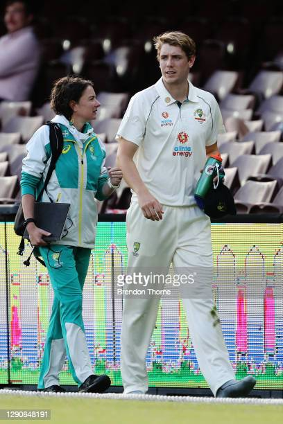 Cameron Green of Australia A leaves the field after being hit in the head from a shot by Jasprit Bumrah of India during day one of the tour match...