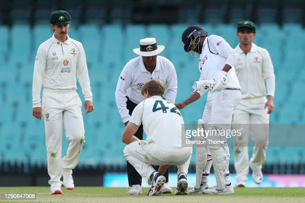 Cameron Green of Australia A reacts after being hit in the head from a shot by Jasprit Bumrah of India during day one of the tour match between...