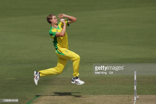 Cameron Green of Australia bowls during game three of the One Day International series between Australia and India at Manuka Oval on December 02,...