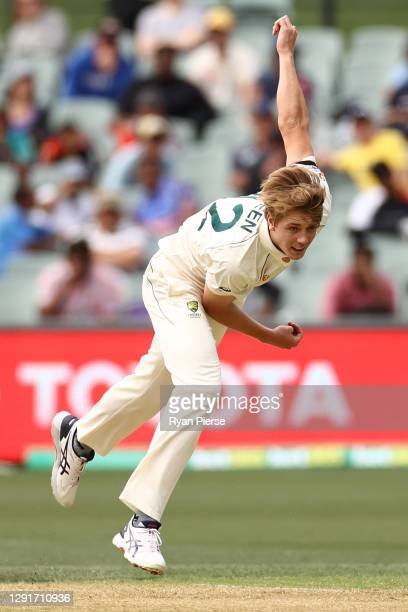Cameron Green of Australia bowls his first ball in test cricket during day one of the First Test match between Australia and India at Adelaide Oval...