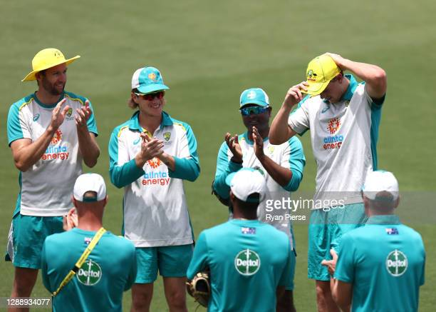 Cameron Green of Australia is congratulated by team mates after receiving his ODI cap ahead of his debut during game three of the One Day...