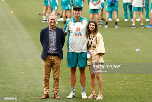 Cameron Green of Australia poses with his father Gary Green and girlfriend Emily Redwood after he received his Baggy Green Cap during day one of the...
