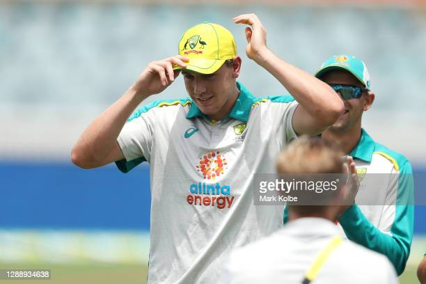 Cameron Green of Australia puts on his Australian cap after the debut cap presentation before game three of the One Day International series between...
