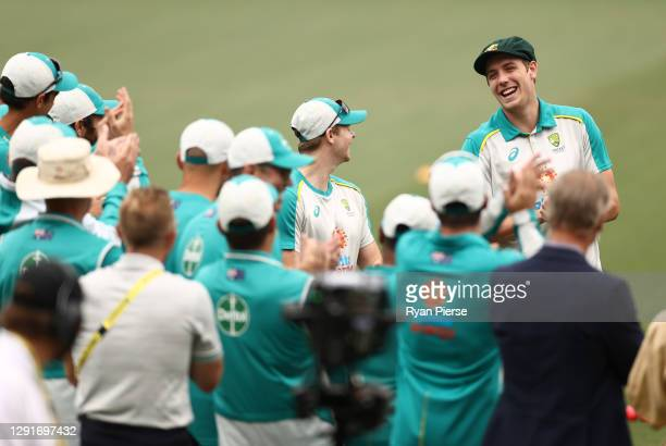 Cameron Green of Australia receives his Baggy Green Cap during day one of the First Test match between Australia and India at Adelaide Oval on...