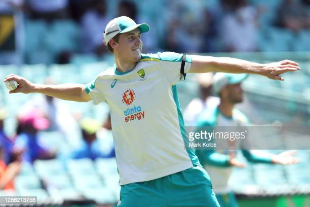 Cameron Green of Australia warms up before game one of the One Day International series between Australia and India at Sydney Cricket Ground on...