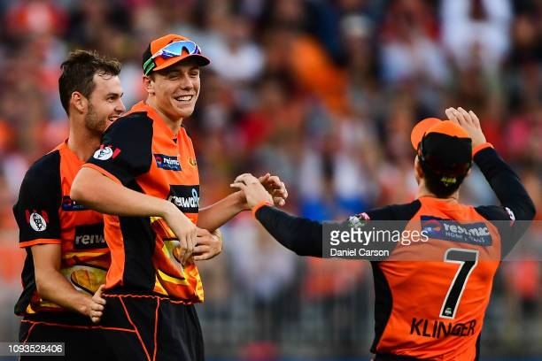 Cameron Green of the Scorchers celebrates taking a diving catch during the Big Bash League match between the Perth Scorchers and the Sydney Sixers at...