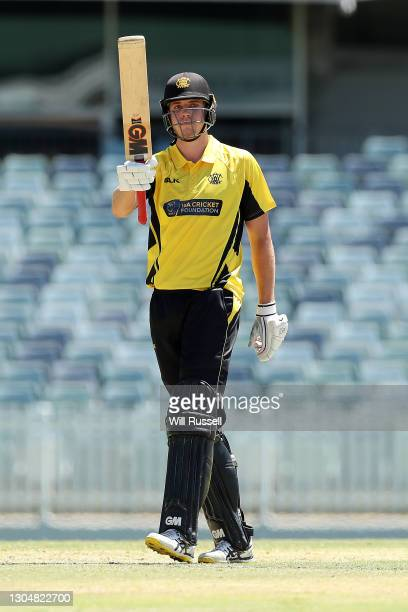 Cameron Green of the Warriors celebrates his half century during the Marsh One Day Cup match between Western Australia and South Australia at WACA on...