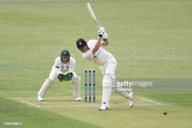 Cameron Green of Western Australia hits the ball for four runs during day one of the Sheffield Shield match between Tasmania and Western Australia at...