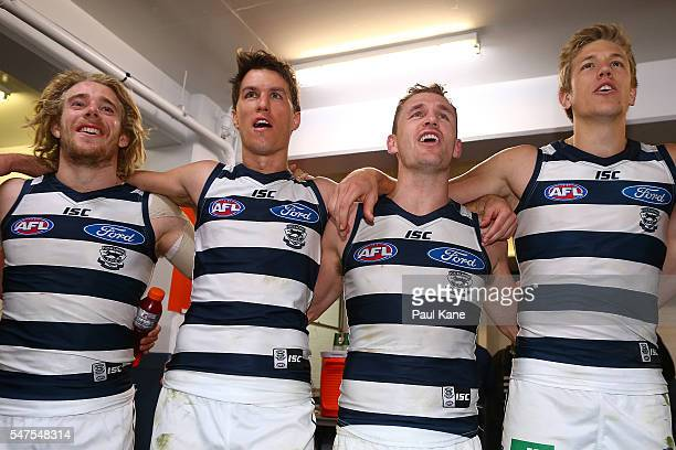 Cameron Guthrie Andrew Mackie Joel Selwood and Rhys Stanley of the Cats sing the club song after winning the round 17 AFL match between the Fremantle...