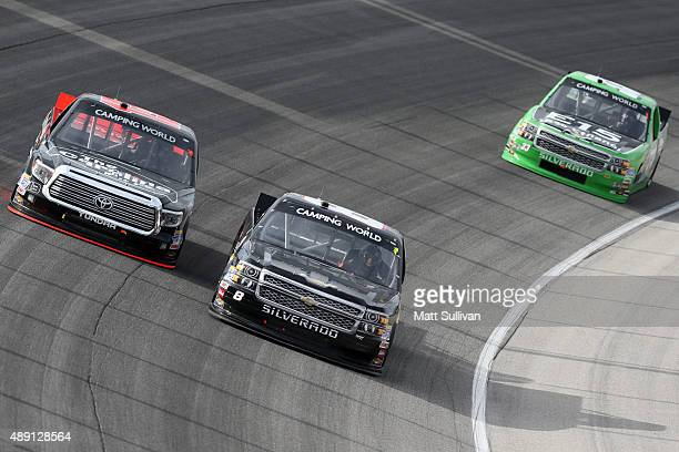 Cameron Hayley driver of the Carolina Nut Co Toyota and John Hunter Nemechek driver of the Chevrolet race during the NASCAR Camping World Truck...