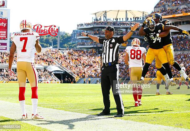 Cameron Heyward and Lawrence Timmons of the Pittsburgh Steelers celebrate following an incomplete pass ruling in front of Colin Kaepernick of the San...