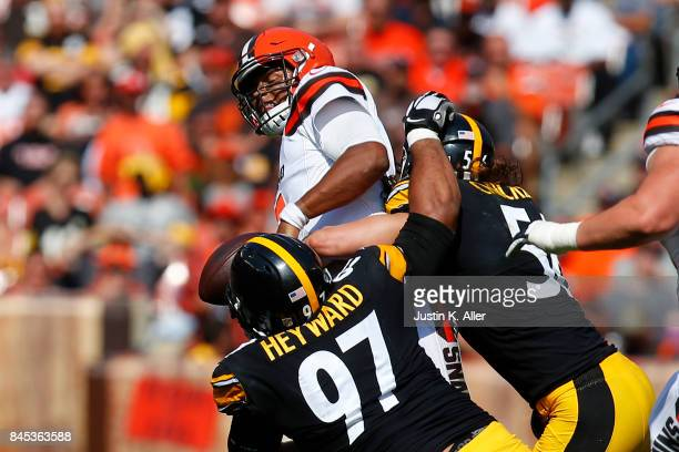 Cameron Heyward of the Pittsburgh Steelers and Anthony Chickillo of the Pittsburgh Steelers sack DeShone Kizer of the Cleveland Browns at FirstEnergy...
