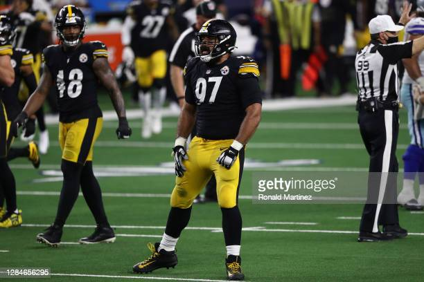 Cameron Heyward of the Pittsburgh Steelers celebrates a sack against Garrett Gilbert of the Dallas Cowboys in the fourth quarter at AT&T Stadium on...