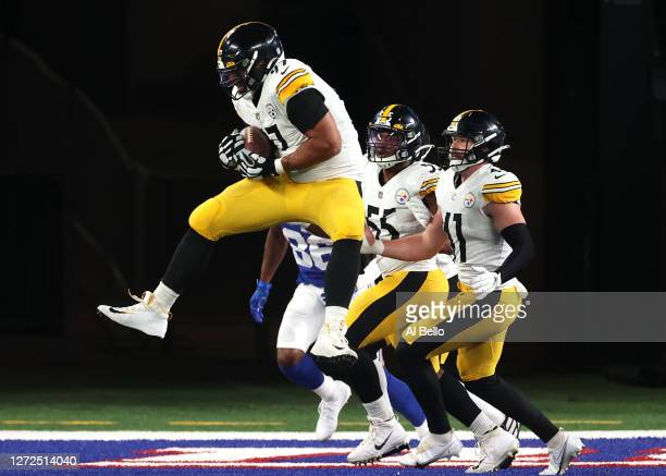 Cameron Heyward of the Pittsburgh Steelers intercepts a pass thrown by Daniel Jones of the New York Giants during the third quarter in the game at...