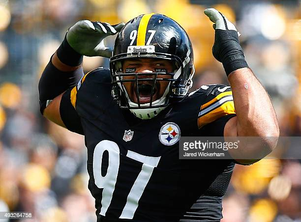 Cameron Heyward of the Pittsburgh Steelers wears eye black with the words 'Iron Head' on them in honor of his late father during the game against the...
