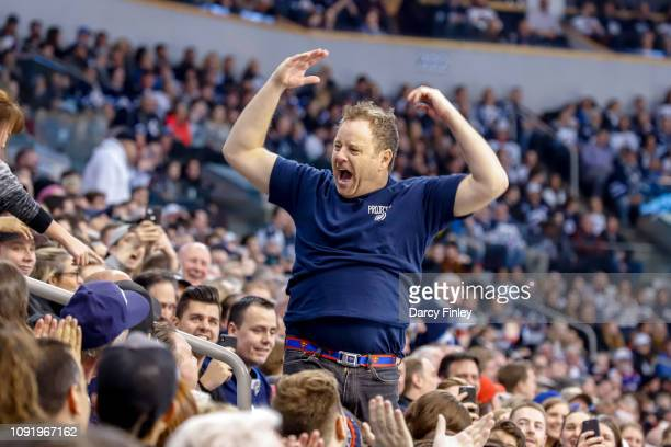 Cameron Hughes pumps up the crowd during a first period stoppage in play between the Winnipeg Jets and the Columbus Blue Jackets at the Bell MTS...