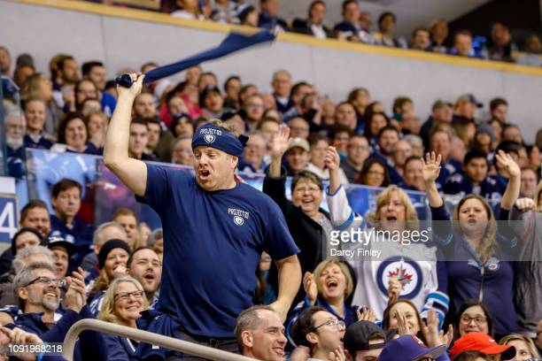 Cameron Hughes pumps up the crowd during third period action between the Winnipeg Jets and the Columbus Blue Jackets at the Bell MTS Place on January...