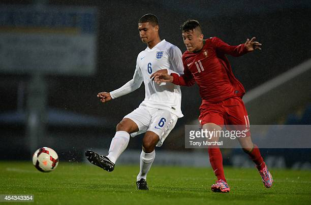 Cameron Humphreys of England is tackled by Tiago Dias of Portugal during the Under 17 International match between England U17 and Portugal U17 at...