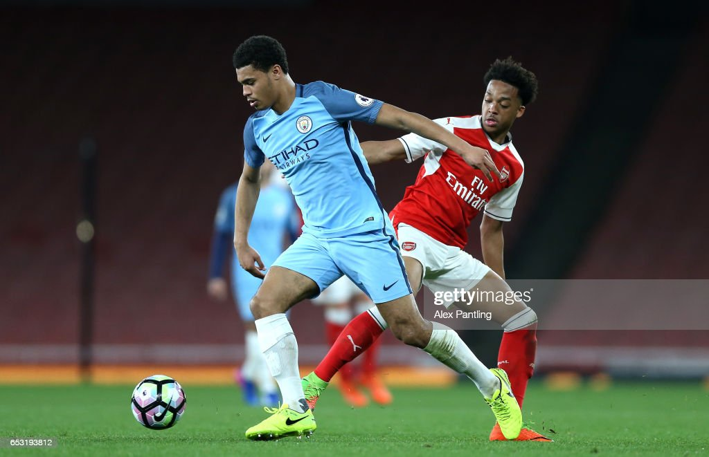Cameron Humphreys of Manchester City and Denzeil Boadu of Manchester City in action during the Premier League 2 match between Arsenal and Manchester City at Emirates Stadium on March 13, 2017 in London, England.