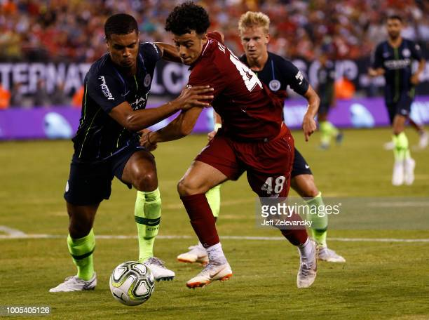 Cameron Humphreys of Manchester City fights for the ball with Curtis Jones of Liverpool during their match at MetLife Stadium on July 25 2018 in East...