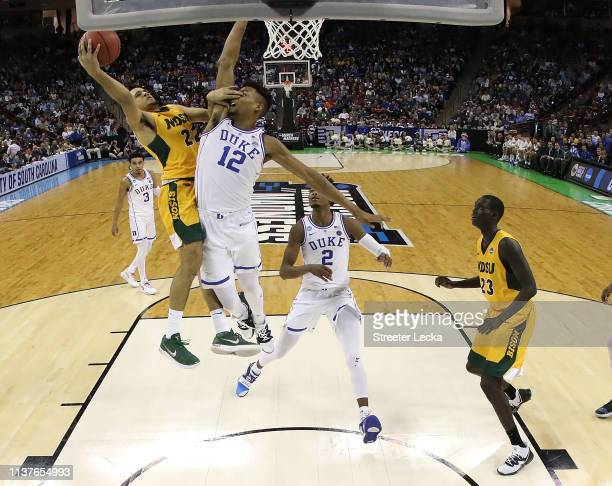 Cameron Hunter of the North Dakota State Bison attempts a shot against Javin DeLaurier of the Duke Blue Devils in the second half during the first...