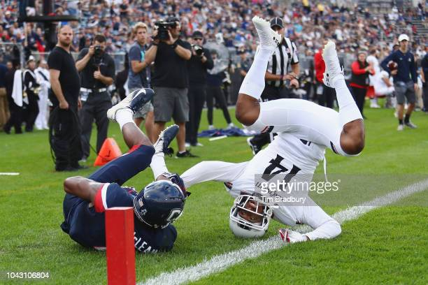 Cameron Jefferies of the Cincinnati Bearcats lands on his head as he breaks up a touchdown pass intended for Aaron McLean of the Connecticut Huskies...