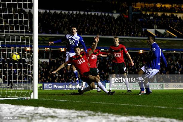 Cameron Jerome of Birmingham City shoots and scores during the Barclays Premier League match between Birmingham City and Manchester United at St...