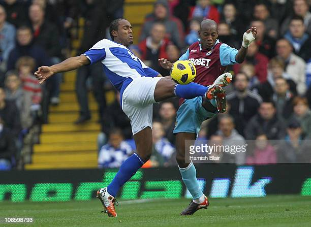 Cameron Jerome of Birmingham contests with Luis Boa Morte of West Ham during the Barclays Premier League match between Birmingham City and West Ham...