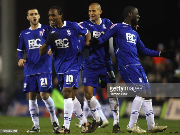 Cameron Jerome of Birmingham is congratulated by team mates after scoring their third goal during the Coca Cola Championship match between Birmingham...