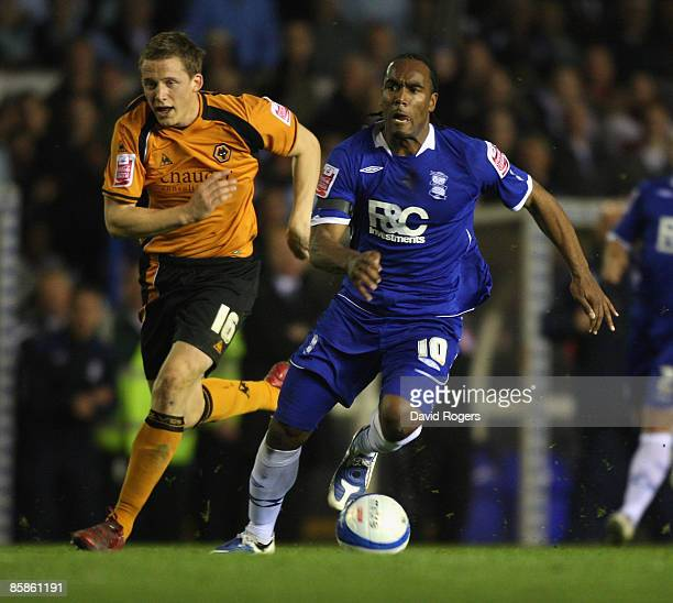 Cameron Jerome of Birmingham runs past Christophe Berra during the CocaCola Championship match between Birmingham City and Wolverhampton Wanderers at...