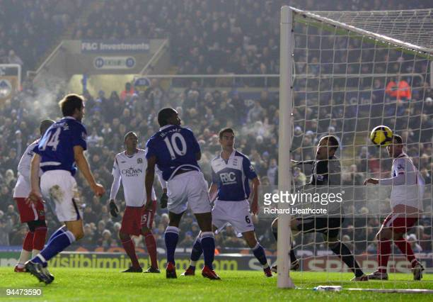 Cameron Jerome of Birmingham scores the first goal during the Barclays Premier League match between Birmingham City and Blackburn Rovers at St...