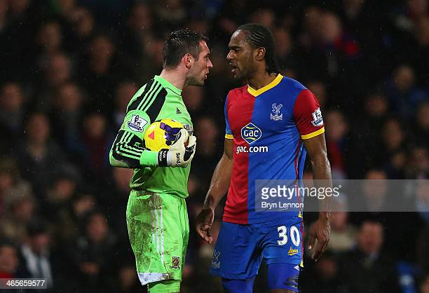 Cameron Jerome of Crystal Palace exchanges words with goalkeeper Allan McGregor of Hull City during the Barclays Premier League match between Crystal...
