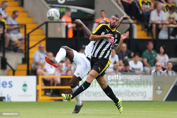 Cameron Jerome of Derby County battles with Richard Duffy of Notts County during a PreSeason match between Notts County and Derby County at Meadow...