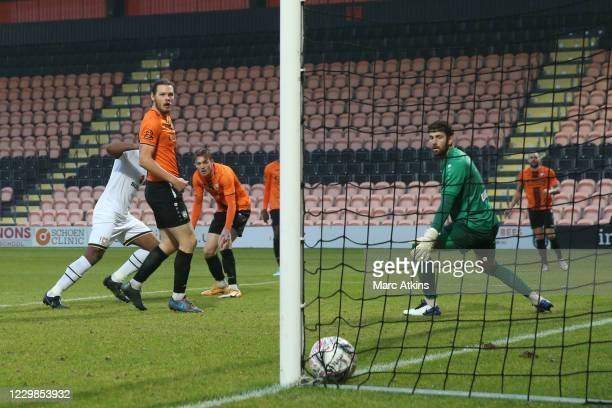 Cameron Jerome of MK Dons scores the winning goal during the Emirates FA Cup Second Round match between Barnet FC and Milton Keynes Dons at The Hive...