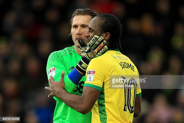 Cameron Jerome of Norwich City and Tomasz Kuszczak of Birmingham City embrace after colliding during the Sky Bet Championship match between Norwich...