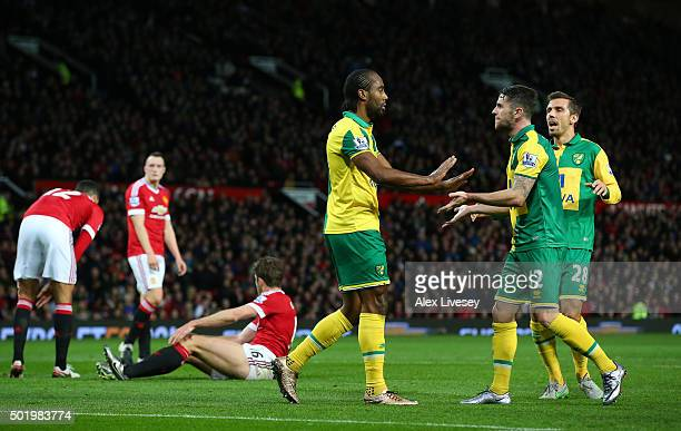 Cameron Jerome of Norwich City celebrates scoring his team's first goal with his team mates Robbie Brady and Gary O'Neil during the Barclays Premier...