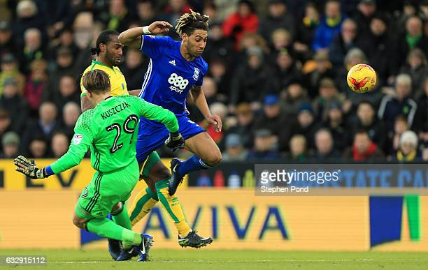 Cameron Jerome of Norwich City collides with Ryan Shotton and Tomasz Kuszczak of Birmingham City during the Sky Bet Championship match between...