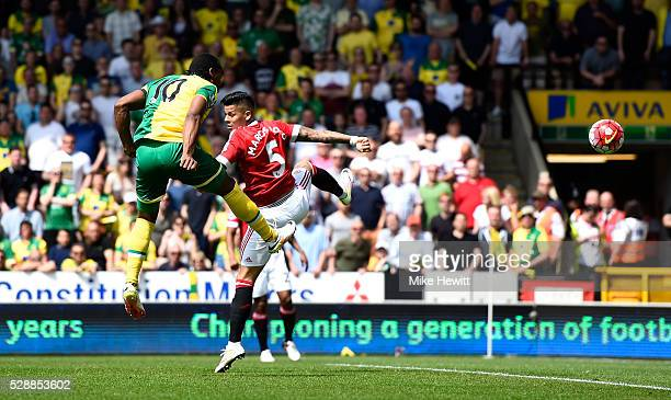 Cameron Jerome of Norwich City heads the ball to shoot at goal `during the Barclays Premier League match between Norwich City and Manchester United...