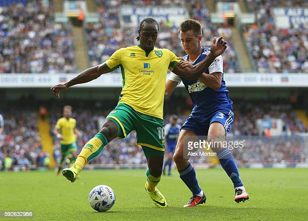 Cameron Jerome of Norwich City is closed down by Jonas Knudsen of Ipswich Town during the Sky Bet Championship match between Ipswich Town and Norwich...