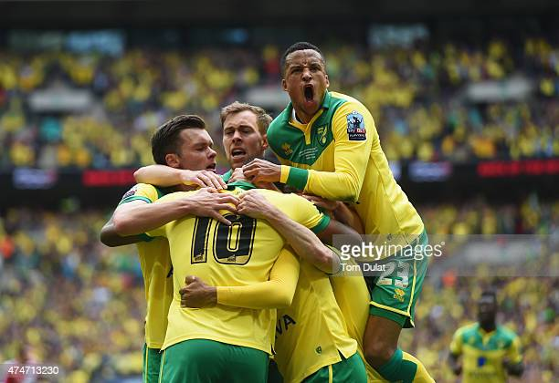 Cameron Jerome of Norwich City is congratulated by Martin Olsson and team mates as he scores their first goal during the Sky Bet Championship Playoff...