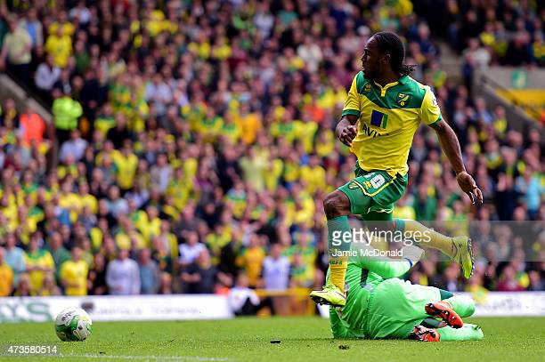 Cameron Jerome of Norwich City scores their third goal past goalkeeper Bartosz Bialkowski of Ipswich Town during the Sky Bet Championship Playoff...