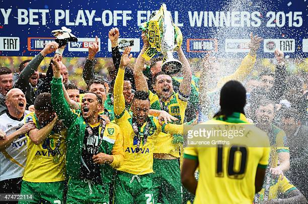 Cameron Jerome of Norwich City sprays his team mates with champagne in celebration after the Sky Bet Championship Playoff Final between Middlesbrough...
