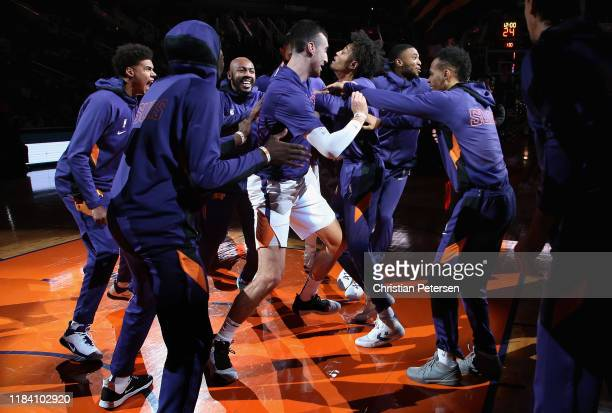 Cameron Johnson Jevon Carter Frank Kaminsky Kelly Oubre Jr #3 Mikal Bridges and Elie Okobo of the Phoenix Suns are introduced before the NBA game...